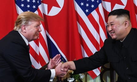 Donald Trump shakes hands with Kim Jong-un following a meeting in Hanoi, Vietnam, on 27 February.