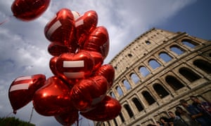 Heart-shaped balloons are released near the Colosseum in Rome