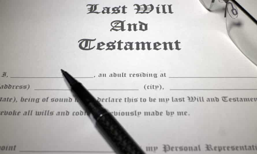 Pen and reading glasses on top of  Last Will and Testament document.