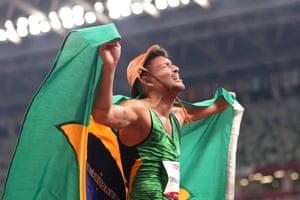 Petrucio Ferreira dos Santos of Team Brazil celebrates after winning gold in the men's 100m T47 final.