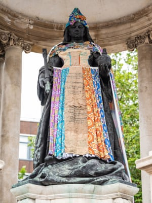 The Queen Victoria monument in Derby Square, Liverpool, is redressed in a cotton dress inspired by Gone With The Wind, highlighting the city's links with the slave trade, designed by Karen Arthur, working with the historian Laurence Westgaph, as part of a project by Sky Arts