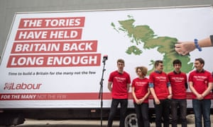 Labour activists in front of the party's first election campaign poster.