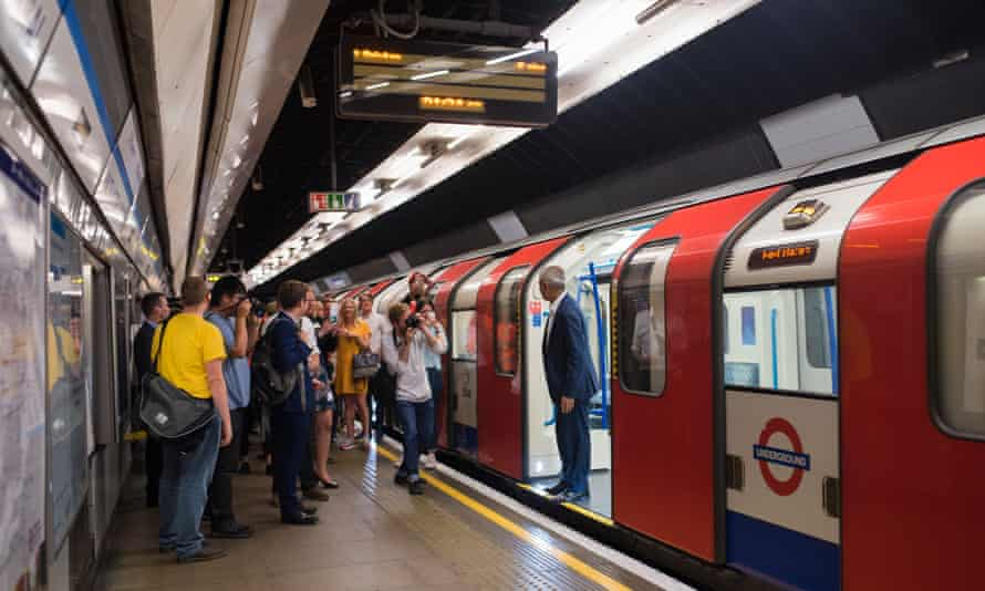 Sadiq Khan boards a Victoria line train in front of the press pack
