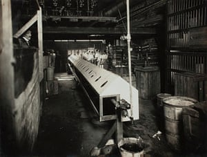 Workers wait to use the 'inhalatorium' at Kodak's Melbourne factory in 1919