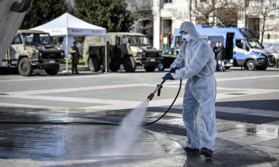 Disinfection in process outside the Centrale railway station in Milan.