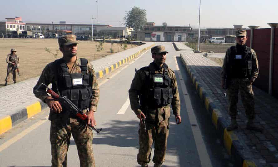 Pakistani soldiers stand guard at the Bacha Khan university.
