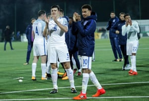 Harry Maguire of England and Dele Alli of England thank and applaud the fans.