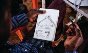 Kéré sketching during a lunch break with colleagues in Koudougou, Burkina Faso.