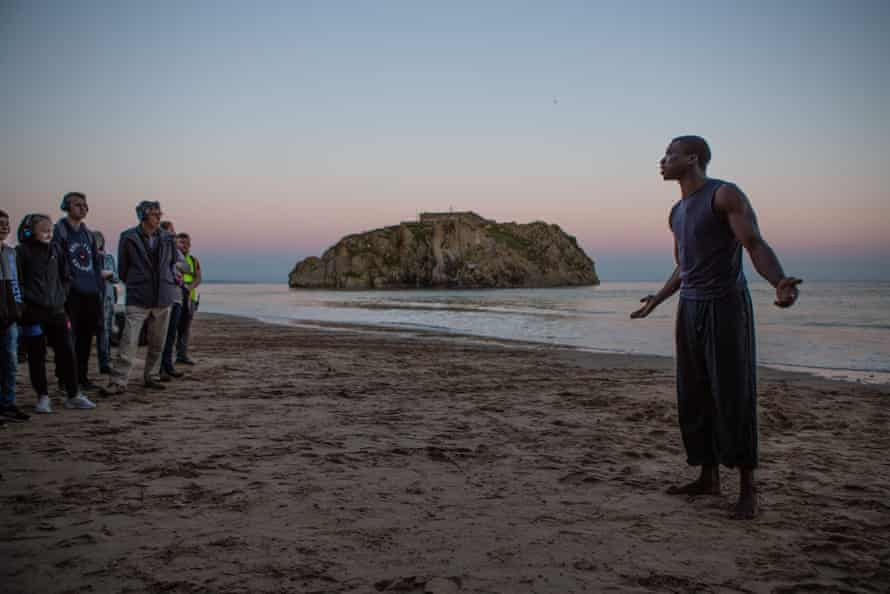 Ebenezer Gyau, right, in Tide Whisperer staged by Kully Thiarai for National Theatre Wales in Tenby, 2018.
