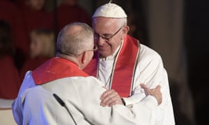 Pope Francis (R) greets Munib Younan, the president of the Lutheran World Federation.