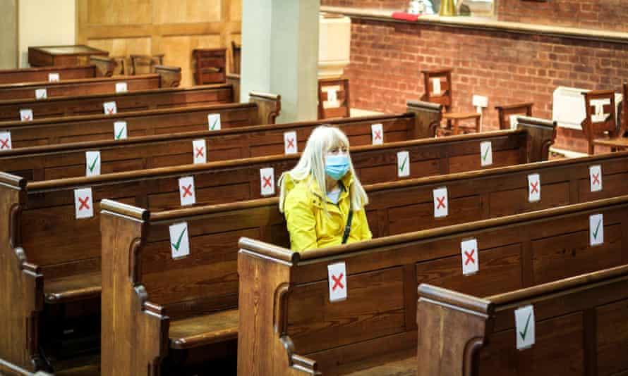 A woman sitting alone in church