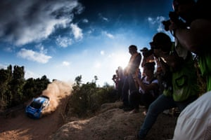 Photographers and spectators train their lenses on Mads Ostberg and his dust trail as he speeds in his Ford Fiesta WRC during the shakedown of Rally Italia Sardegna 2016.