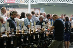 There's tuns of people here: punters head to the pumps to sample some of the 500 beers on offer.