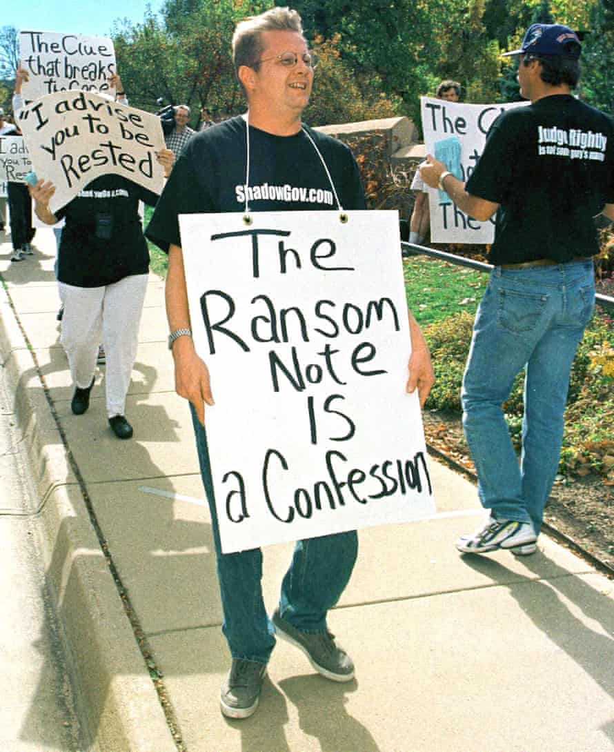 Protesters unhappy at the lack of a decision in the murder case march outside the justice centre in Boulder, Colorado, in 1999