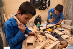 Children learn woodcarving, among other activities, at the school founded by Abdul Baqi Samandar.