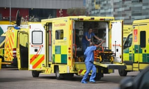 Medical staff outside the NHS Nightingale hospital in London in April