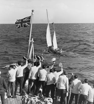 A ship's crew welcomes English sailor Robin Knox-Johnston on board his 32-foot (9.8-metre) boat Suhaili, as he nears Falmouth, 23 April 1969.