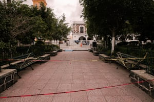 The main park in Izucar de Matamoros is taped off to prevent people gathering.