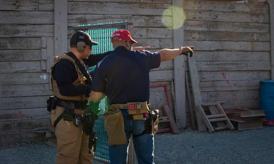 A veteran firearm instructor with the Black Gun Owners Association gives pointers during a drill at the Richmond Rod & Gun Club.