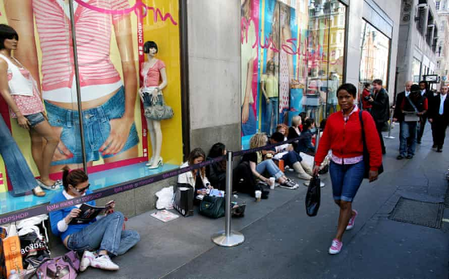 Shoppers queue in Oxford Circus for a Topshop/Kate Moss collaboration. Photograph: Graeme Robertson/Guardian