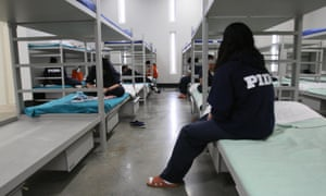 Female detainees sit on their bunks in the dormitory of the Alpha Unit at Port Isabel detention facility in Texas.