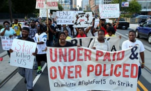 Demonstrators march to protest about the police shooting of Keith Scott in Charlotte.