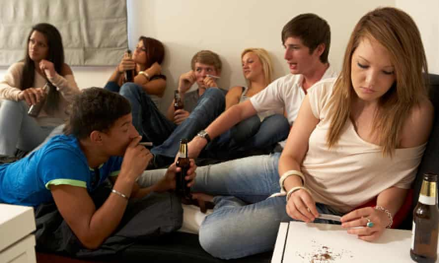 Teenagers drinking and smoking in a room