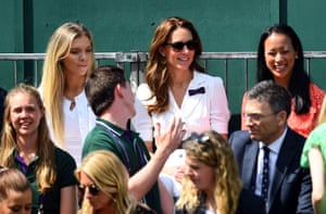 The Duchess of Cambridge with Katie Boulter (left) and Anne Keothavong (right) on an outside court for the first round match between Harriet Dart and Christina McHale.