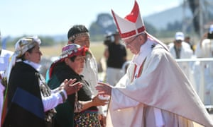 Pope Francis greets Mapuche people during a mass mass at Maquehue airport, near Temuco, Chile, on Wednesday.