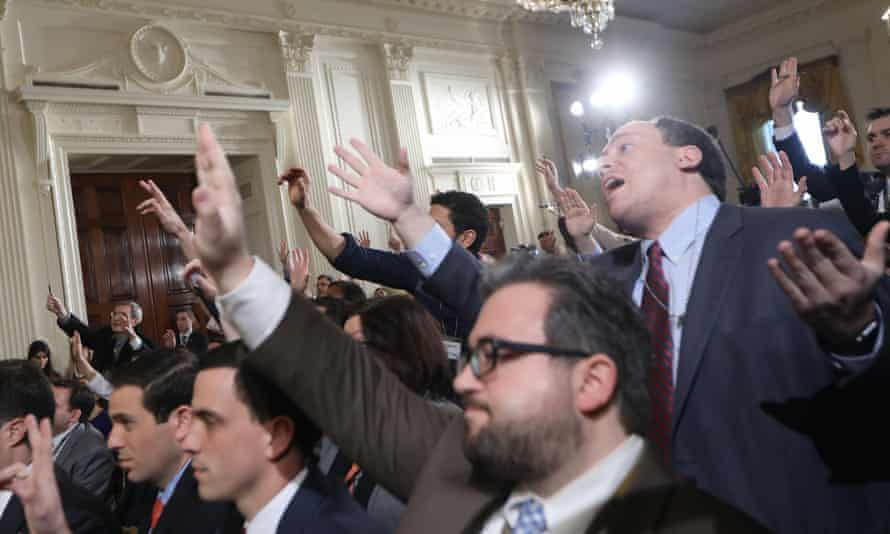 Reporters attempt to pose questions to Donald Trump during the press conference.