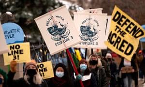 People protest the Enbridge Energy Line 3 oil pipeline project in St Paul, Minnesota.