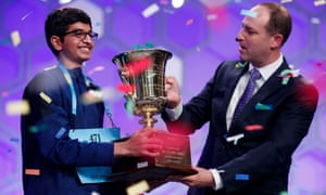 Karthik Nemmani  receives the championship trophy after winning the National Spelling Bee