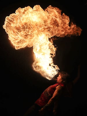 A man breathes fire during the Phoenix fire festival in Lida, Belarus