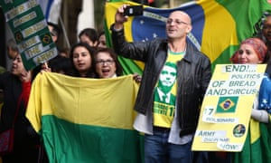 Supporters of candidate Jair Bolsonaro, of the Social Liberal Party in Brazil's general election outside the Embassy of Brazil in London.