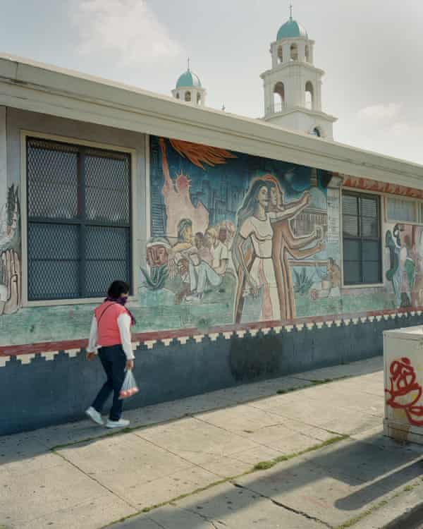 The mural, Homage to America, by muralist Jose Meza Velasquez, is painted on the side of a United States Postal Service building in Fruitvale, California.