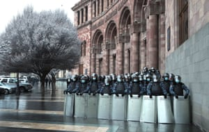 Yerevan, Armenia: Law enforcement officers stand guard outside the offices of the Armenian Government