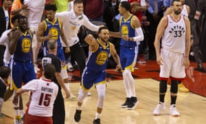 Stephen Curry and the Warriors celebrate their thrilling win over the Raptors.