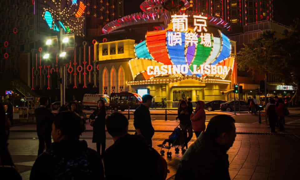 Pedestrians in front of the Casino Grand Lisboa, Macau, China