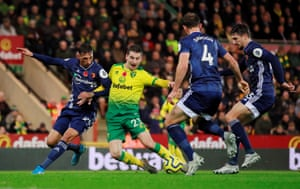 Norwich City's Kenny McLean goes down in the box as he is challenged by Watford's Jose Holebas.