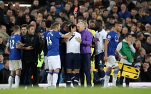 Tottenham Hotspur's Son Heung-min is shown a red card by referee Martin Atkinson.