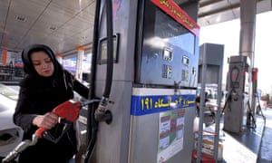 A woman filling up her car in Tehran