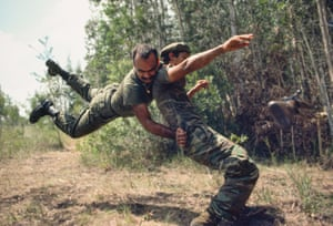 Cuban-born members of paramilitary group Alpha 66 combat training at a camp west of Miami in 1981. Alpha 66 was a CIA-funded paramilitary group of Cuban exiles opposed to the Cuban government of Fidel Castro and committed to overthrowing it and him. The Cuban government considered Alpha 66 to be a terrorist organisation