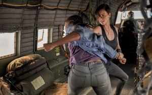 KiKi Layne and Charlize Theron fight it out in The Old Guard.