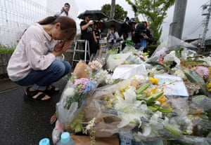 Mourners leave floral tributes at the scene of the blaze.