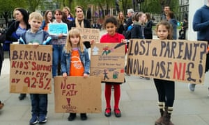 People demonstrate outside the Houses of Parliament over changes to the widowed parents' allowance.