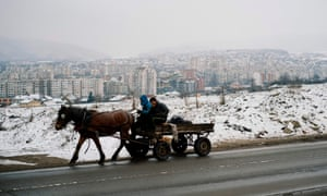Men ride on a horse cart in the predominantly Roma suburb of Fakulteta on the outskirts of Sofia