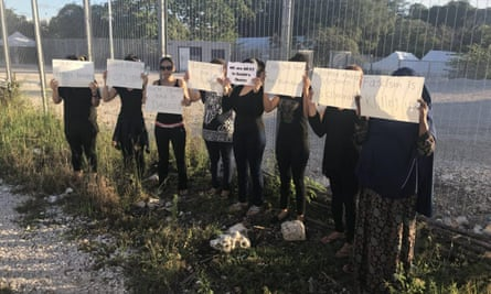 Displaced women on their black clothes, stand in solidarity with mourning mother Faezeh Mansour Beigi on Nauru.