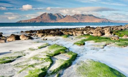 The Isle of Rum from Laig Bay, Eigg, Scotland, United Kingdom.