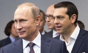 Putin and Tsipras arrive for talks.
