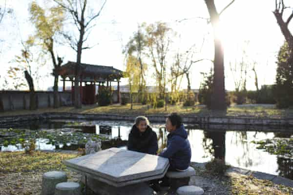 Akiko Ota (right) and Tsuruko Suzuki (left) talking to each other in a park. Since they left Japan more than 50 years ago, they haven't been able to return to visit the families they left behind.